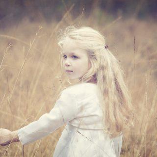 Cute little girl, blonde, wind, grass_3840x2400